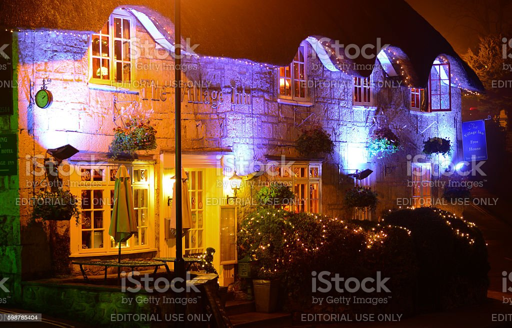 The Village Inn at Night stock photo