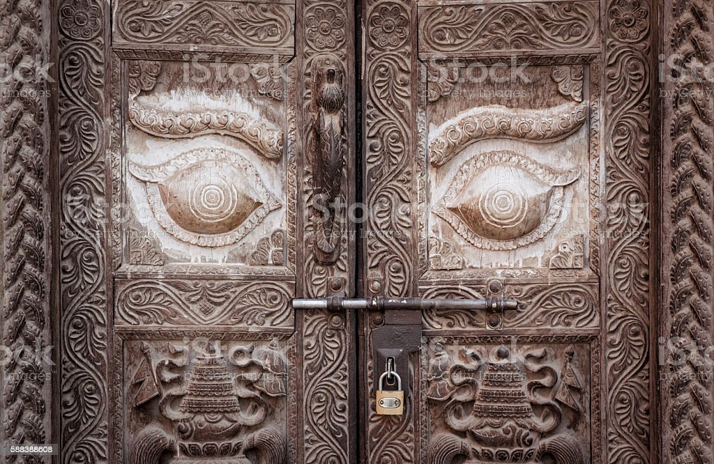 The vintage door in Nepalese style. stock photo