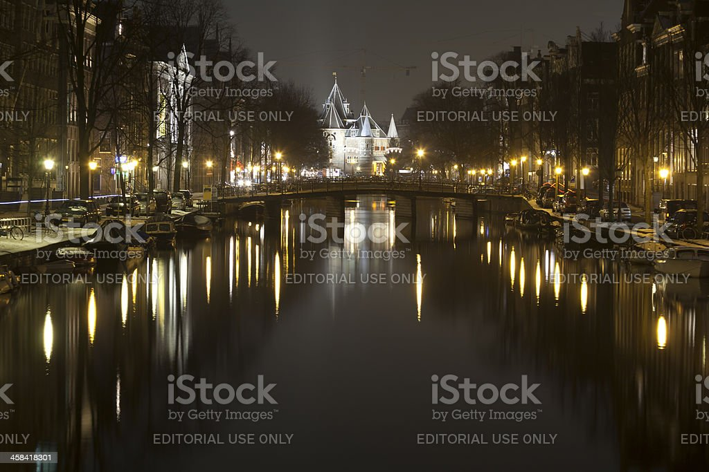 The Waag in  Amsterdam at night stock photo