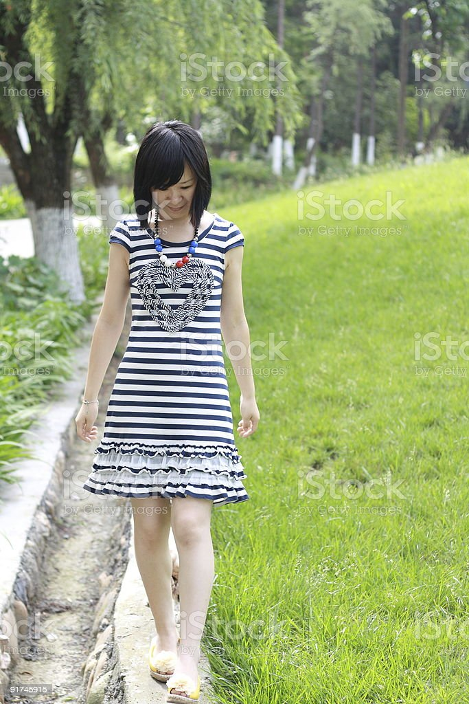 The walking girl in spring royalty-free stock photo