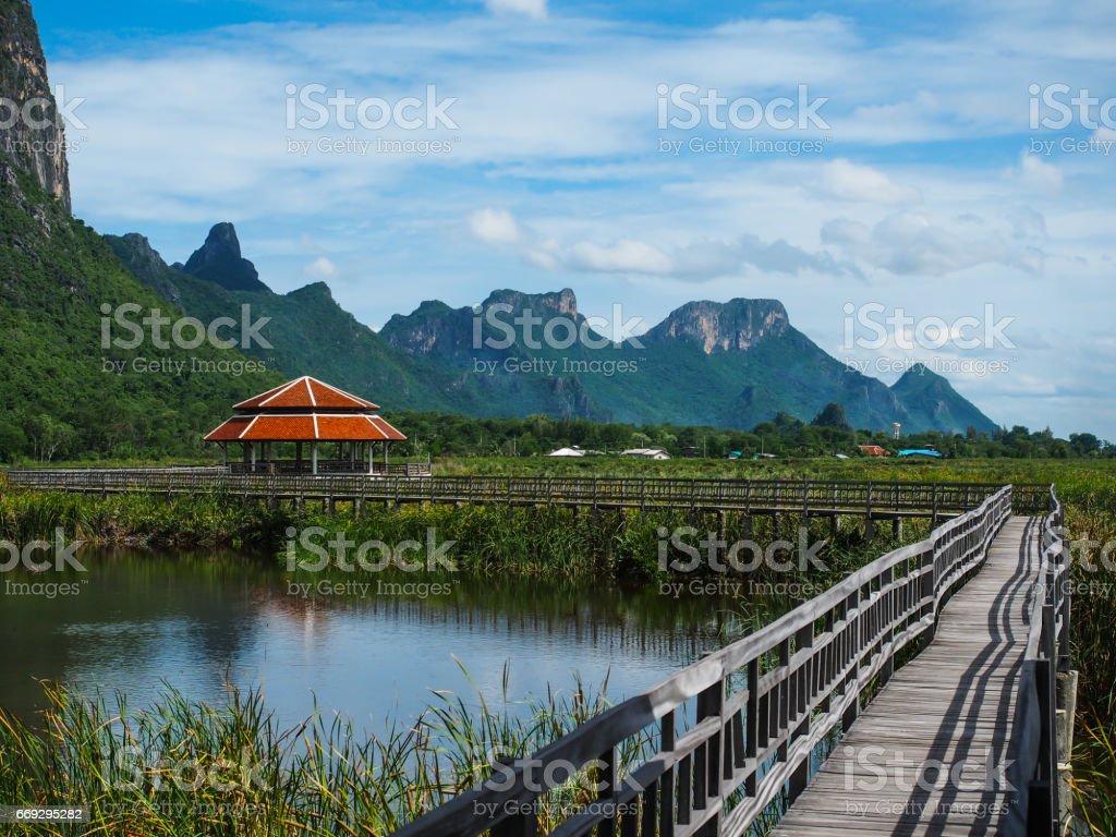 The walkway with the nature view of lake and mountains, Khao Sam Roi Yot, Prachuap Khiri Khan, Thailand. stock photo