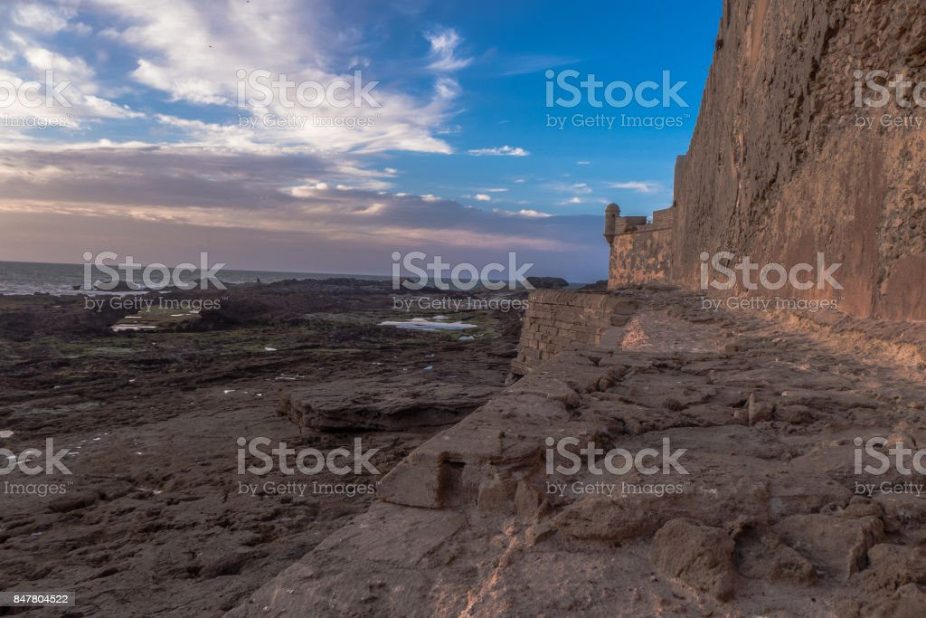 The wall between the sea and the city. stock photo