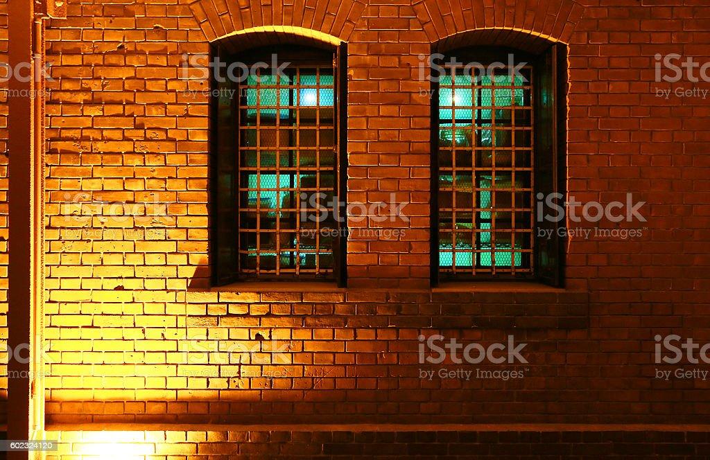 The wall of the brick and orange light foto de stock libre de derechos