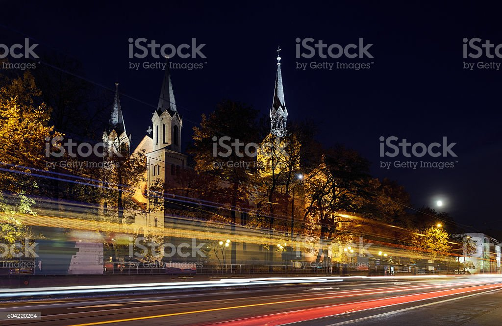 The Warsaw street and the church in the evening in Katowice stock photo