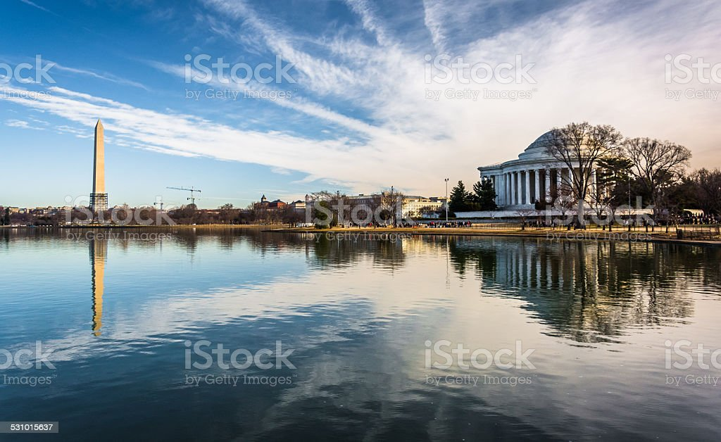 The Washington Monument and Thomas Jefferson Memorial reflecting stock photo