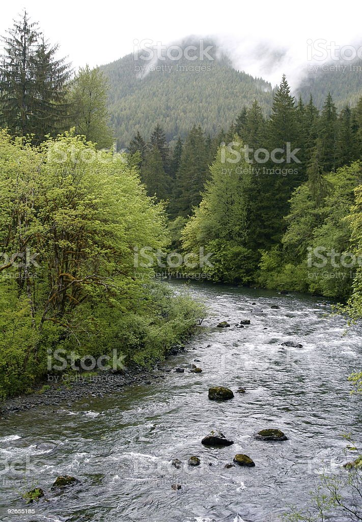 The Water Cycle With Rain Clouds and River stock photo