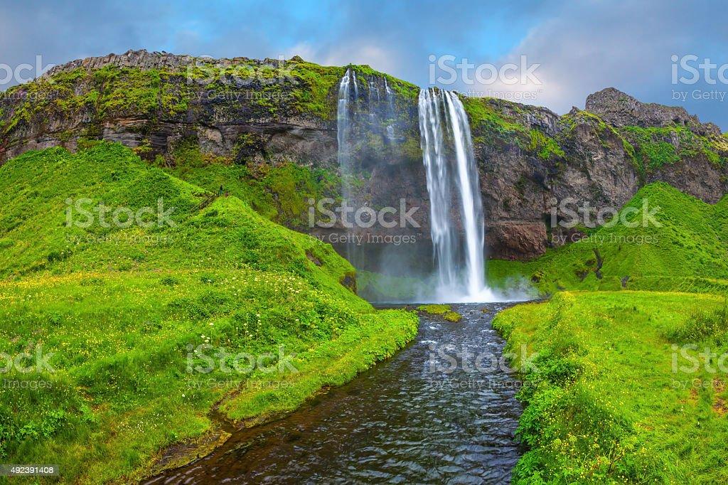 The water flows through  rapid stream stock photo