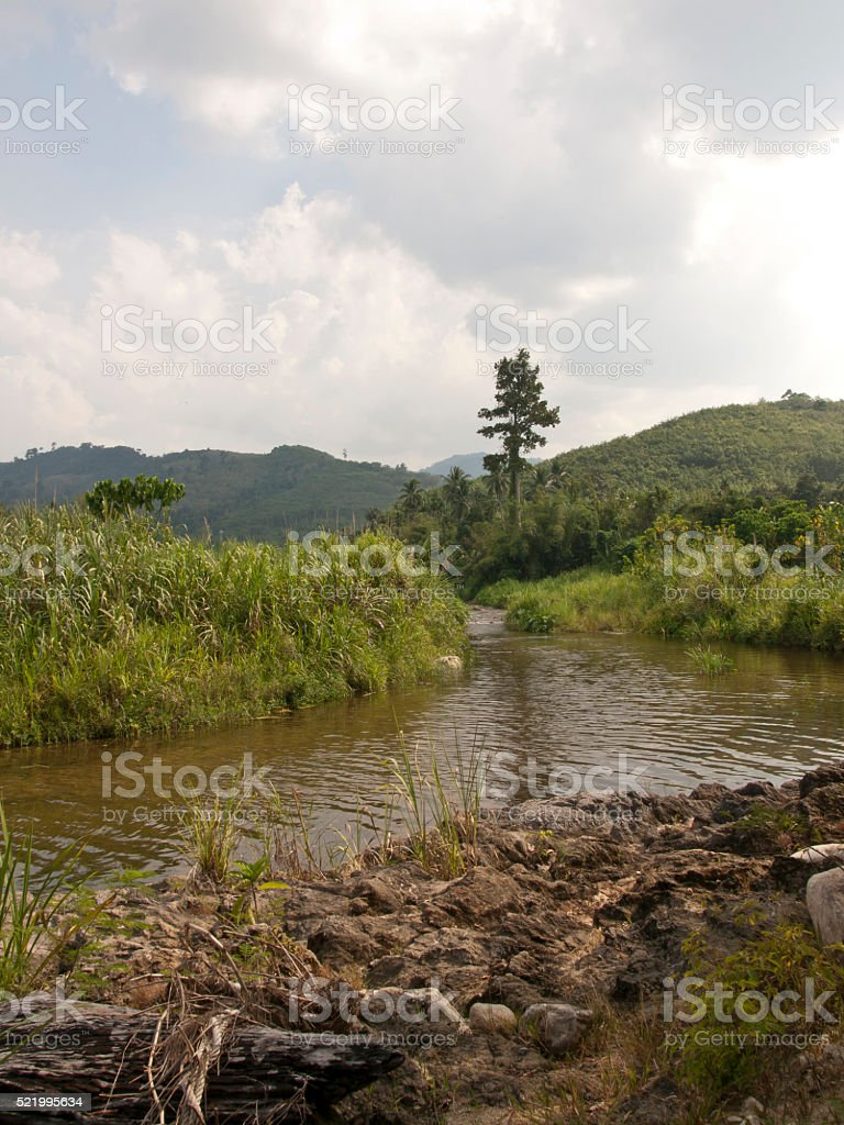 The water stream flow from mountain stock photo