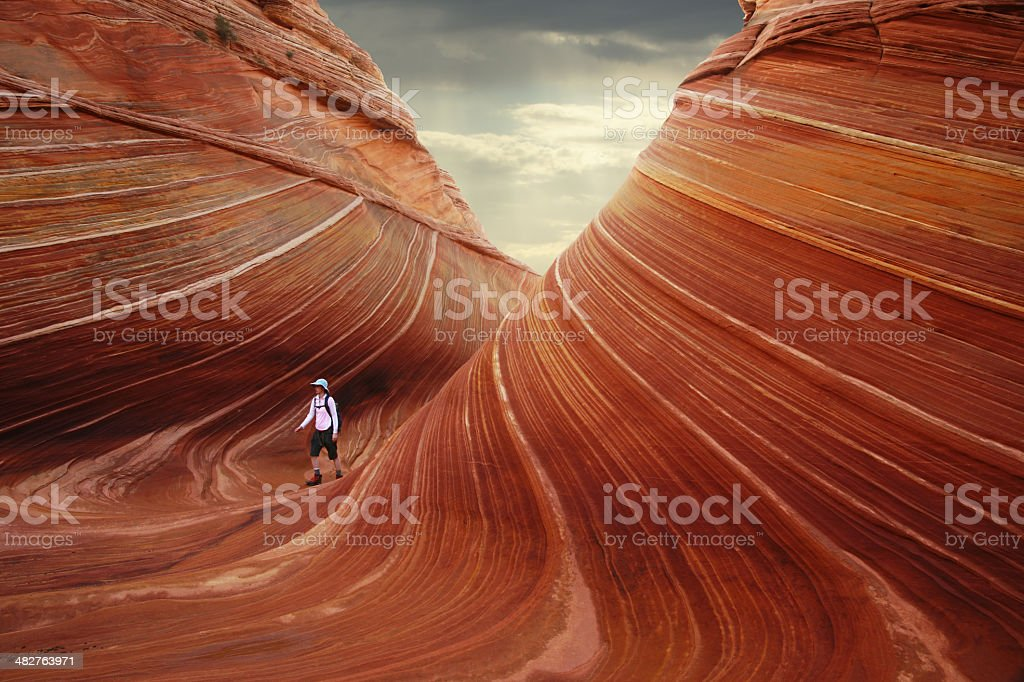 The Wave at North Coyote Buttes with Hiker royalty-free stock photo