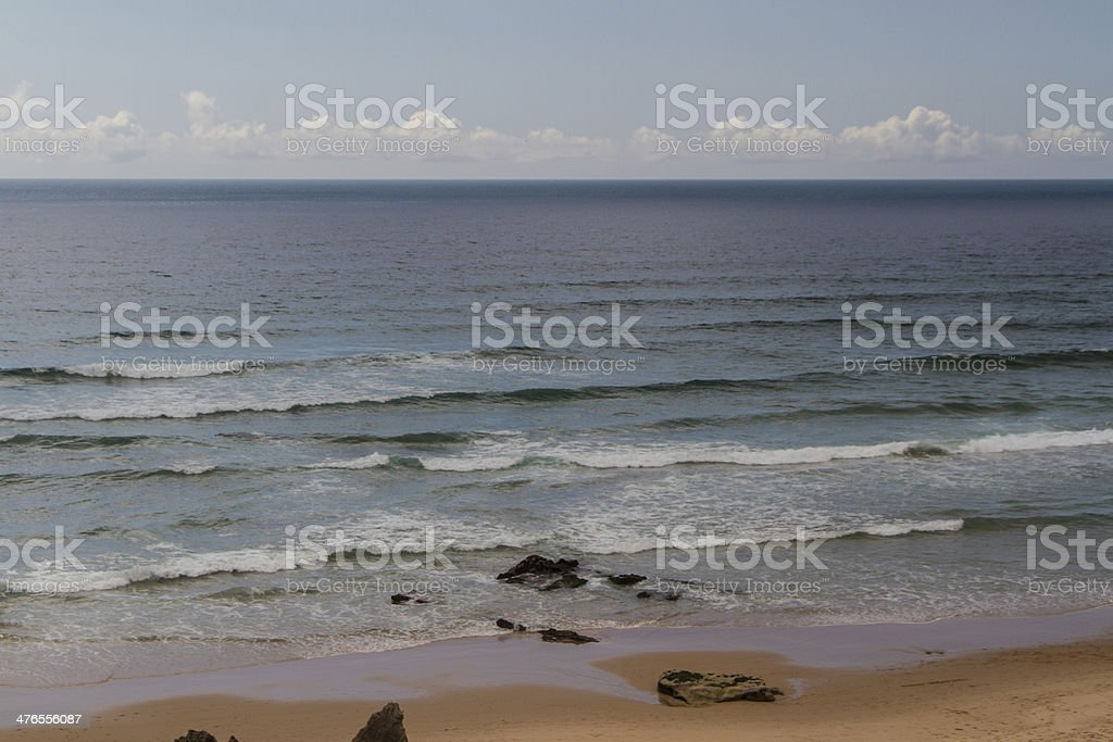 The waves fighting about deserted rocky coast of Atlantic ocean, royalty-free stock photo