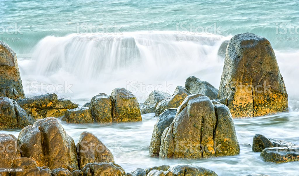 The waves swept the stunning reefs stock photo