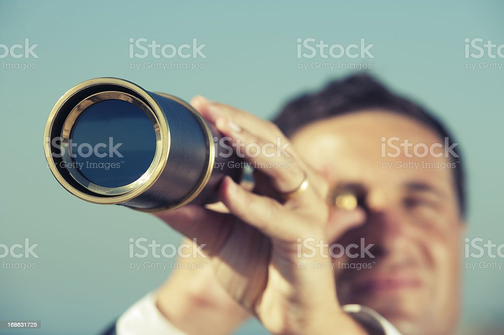 The way forward. Businessman looking through a telescope stock photo