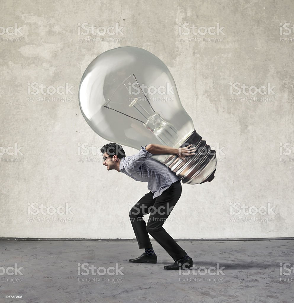 The weight of hard work stock photo