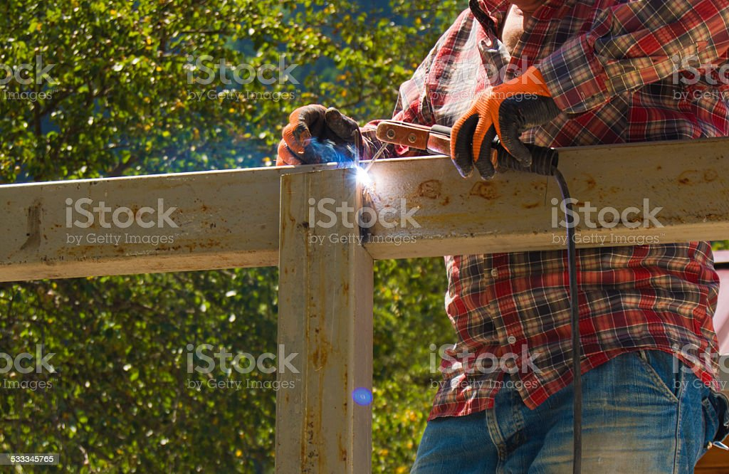 The Welder on a construction stock photo