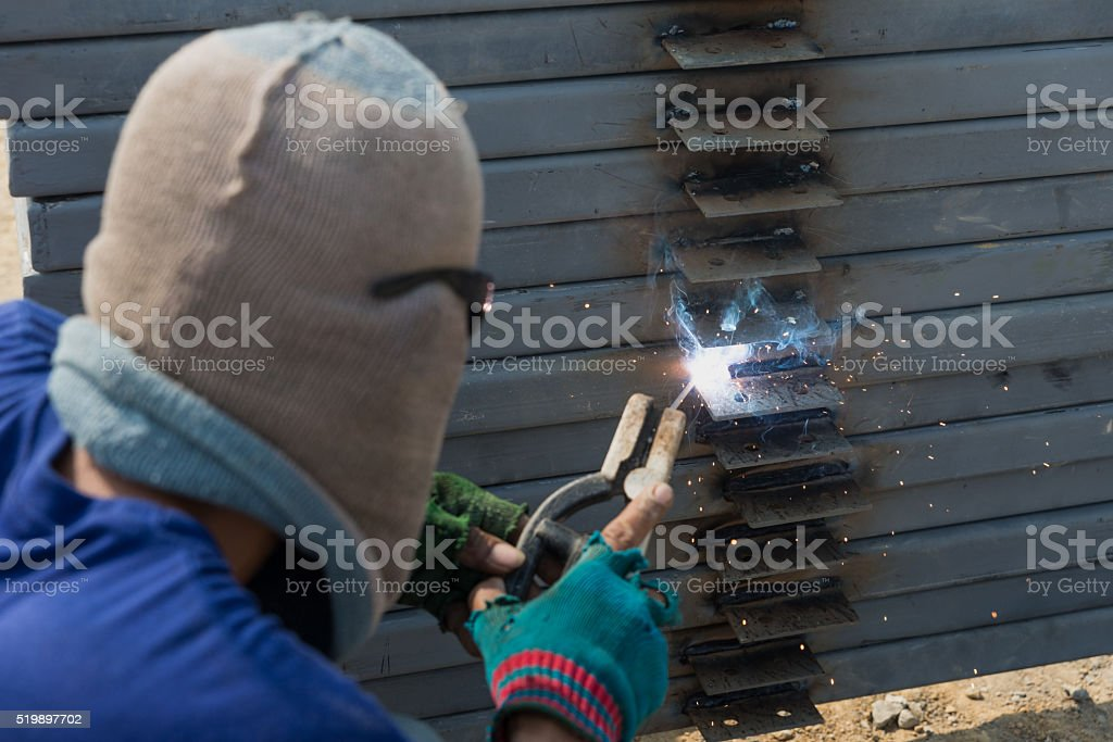 The welder without personal safety protection stock photo
