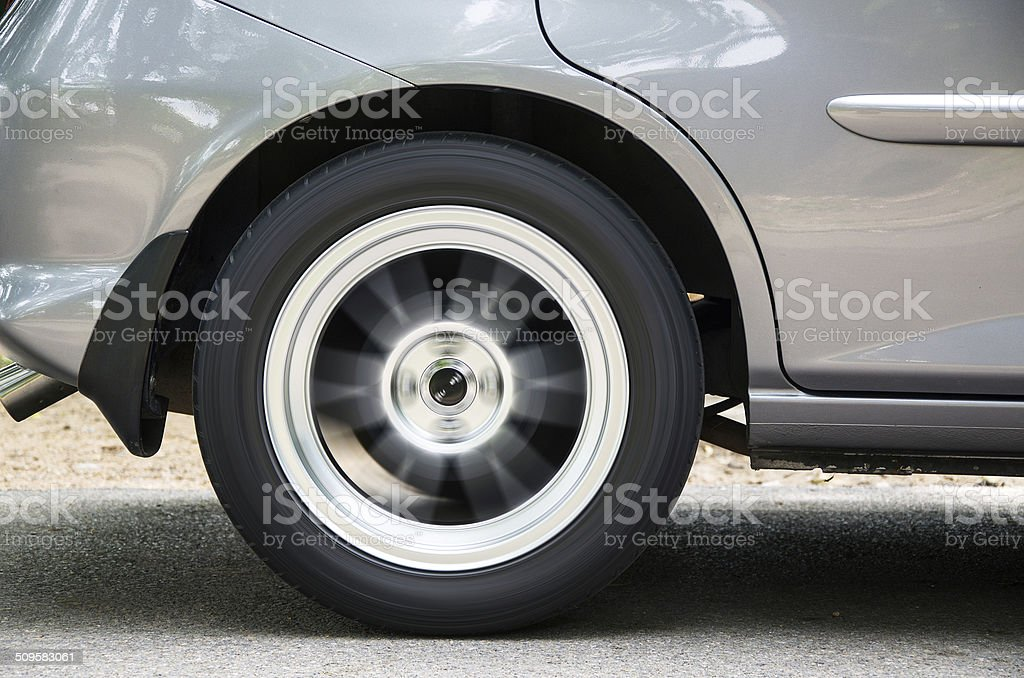 The wheel spinning on concrete stock photo