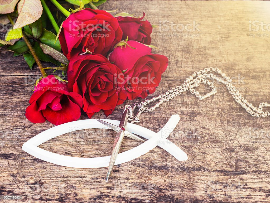 The white christian fish and metal silver cross stock photo