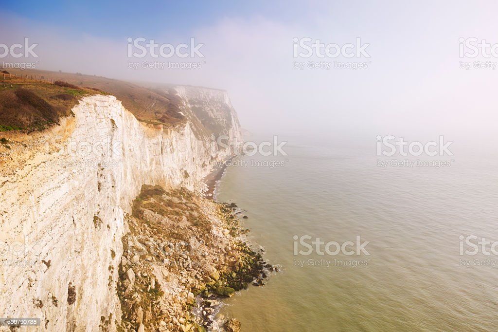 The white cliffs of Dover on a foggy morning stock photo
