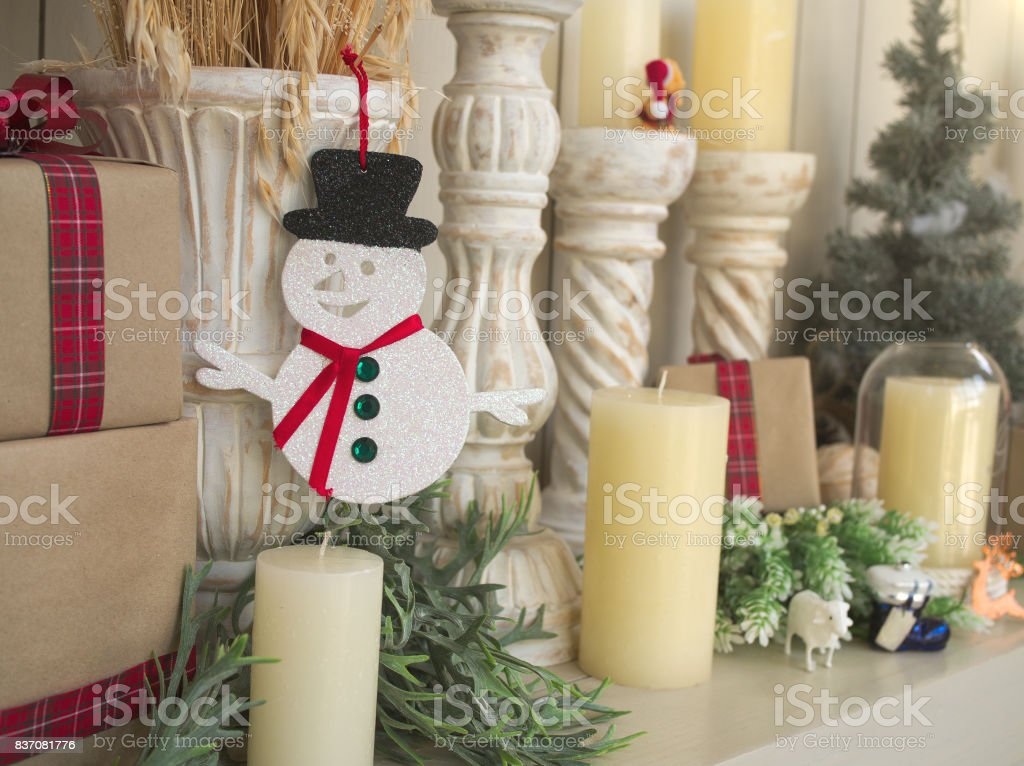 The white glossy christmas decoration of snowman with red scarf and black hat stock photo