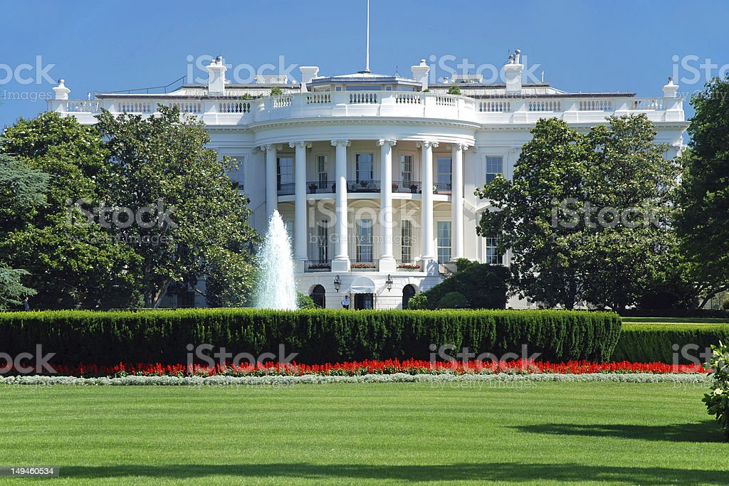 The White House in Washington DC with beautiful blue sky stock photo