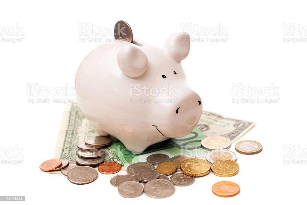 The white porcelain pig with coins and banknotes stock photo