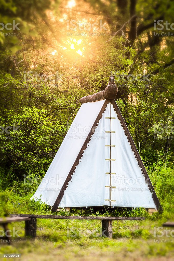 The white tent in the woods stock photo
