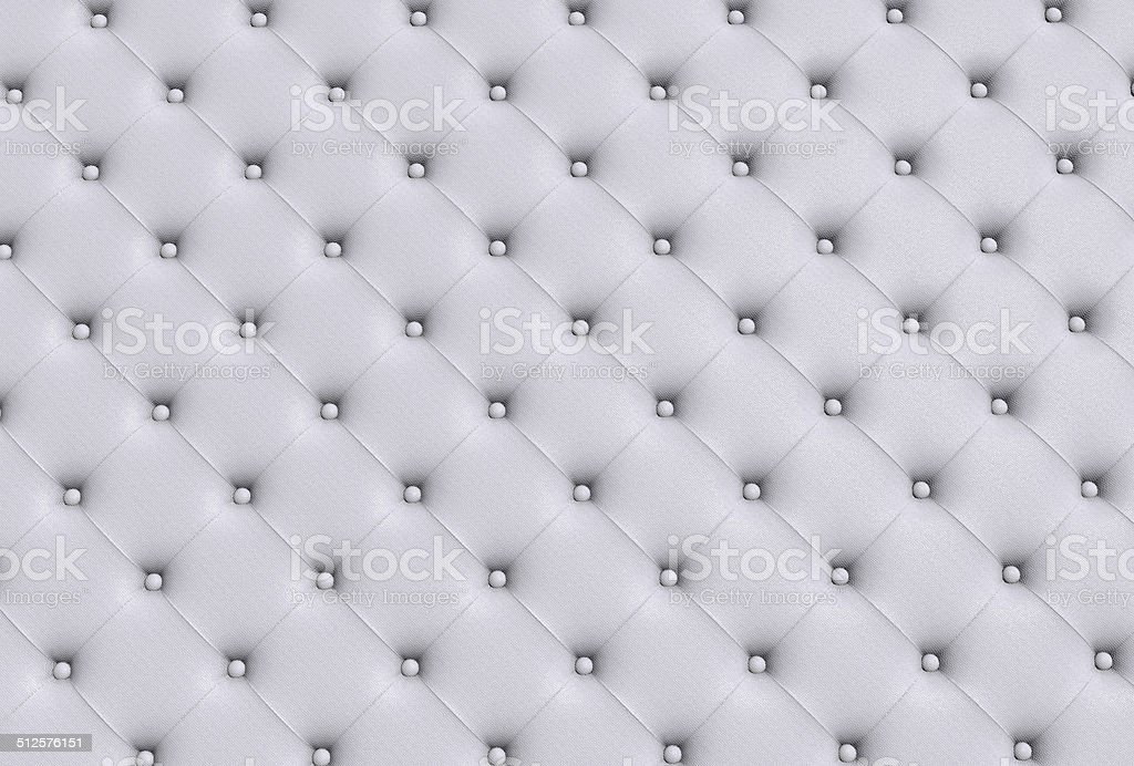 the white texture of the skin quilted sofa stock photo