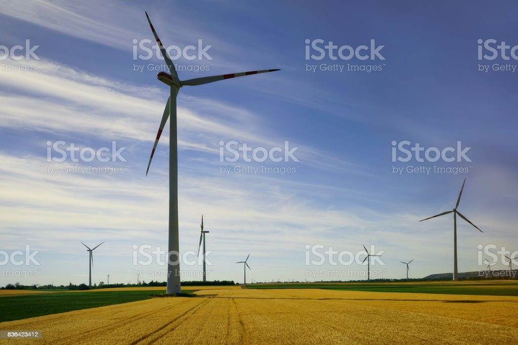 The wind mill in Europe's country side with the nice blue sky during summer stock photo