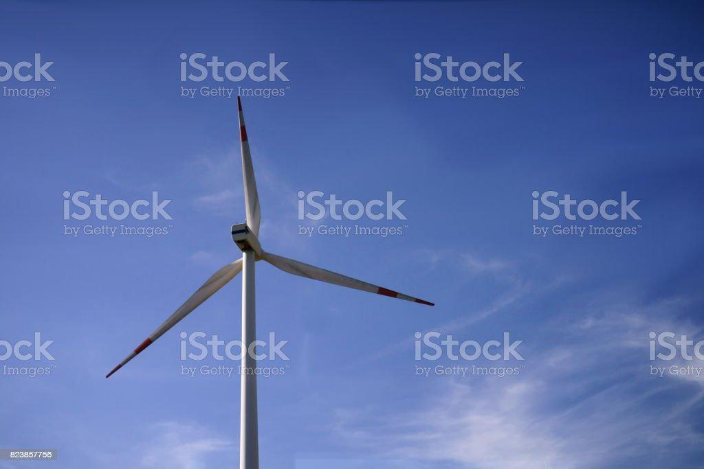 The wind turbine with nice blue sky stock photo