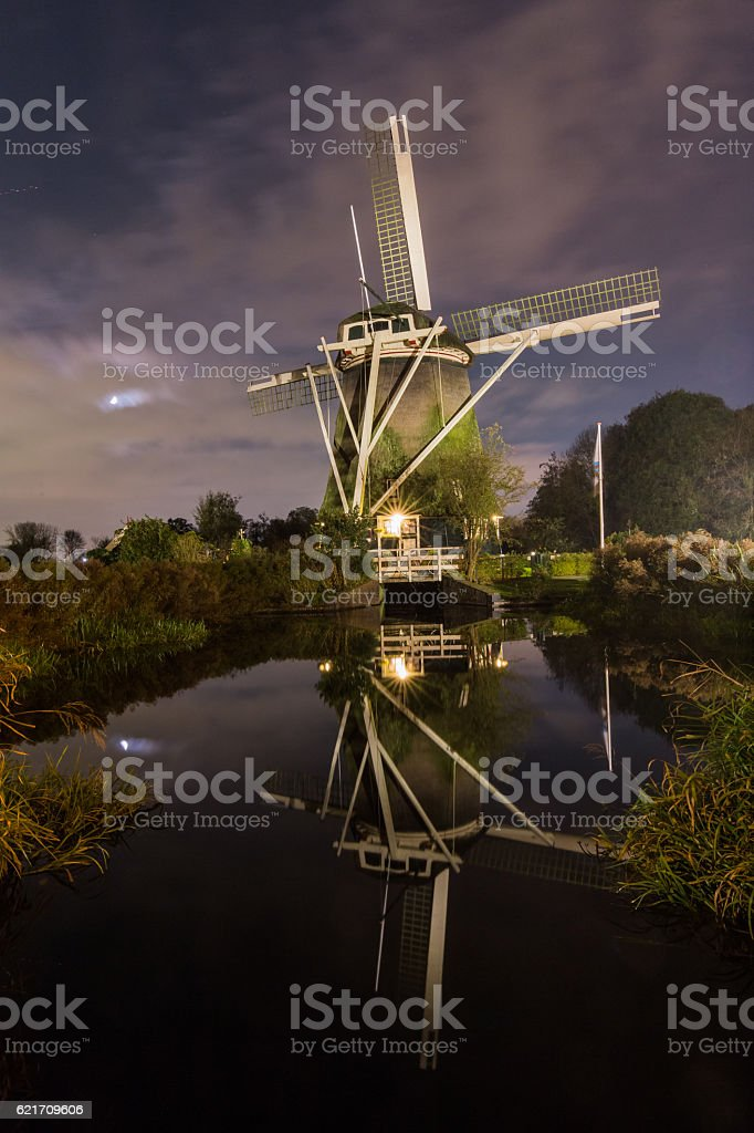 The windmill called Riekermolen at the Amstel river in Amsterdam stock photo