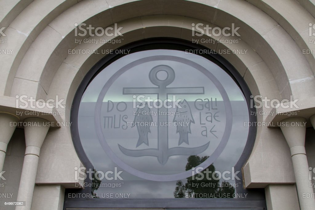 The window, anchor and fish symbols in Domus Galilaeae, Israel stock photo