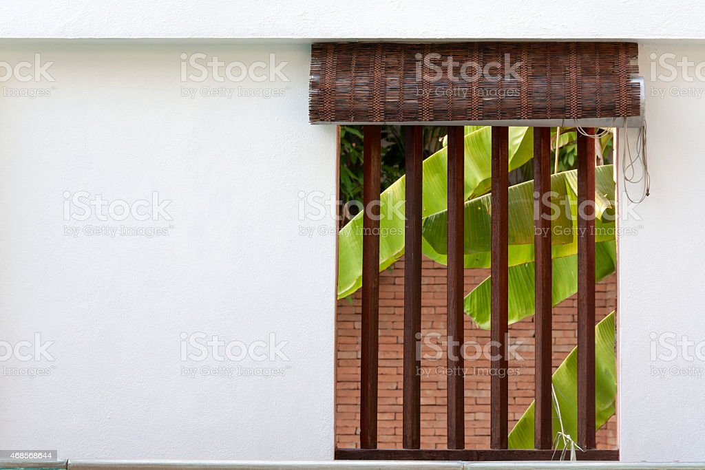 The  window on the white cement wall royalty-free stock photo