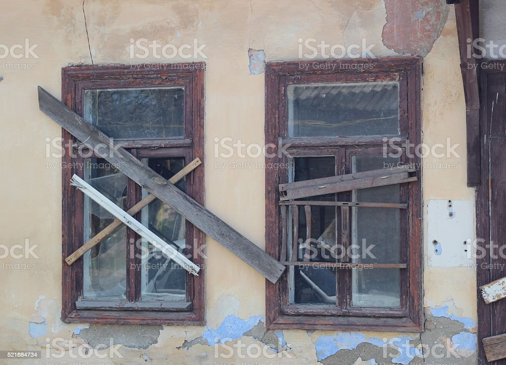 The windows of an abandoned house stock photo
