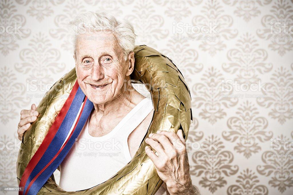 The Winner - senior man with golden laurel wreath royalty-free stock photo