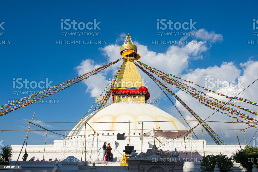 The Wisdom eyes on Boudhanath stupa landmark of Kathmandu stock photo
