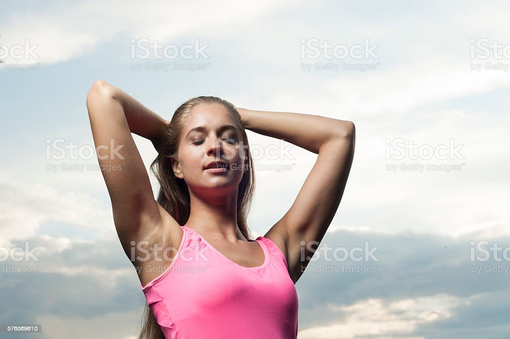 The woman against the sky stock photo