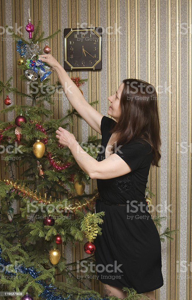 The woman and a fur-tree stock photo