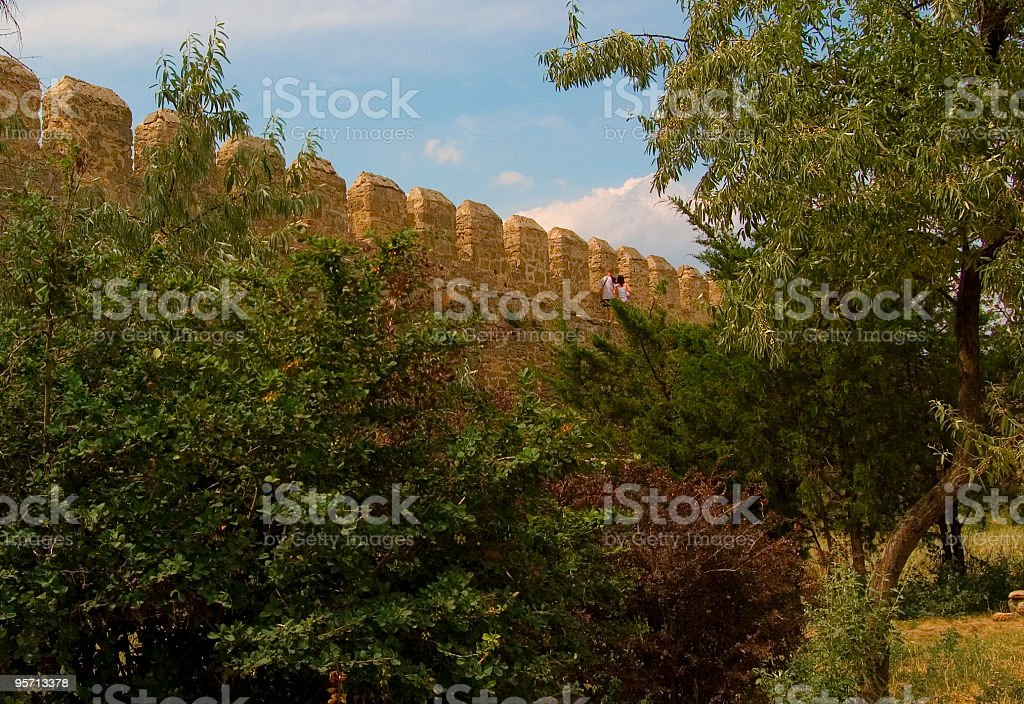 the woman and man walk on old fortress. stock photo
