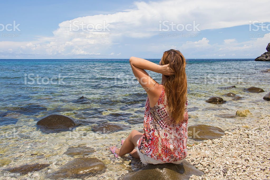 The woman and the sea stock photo