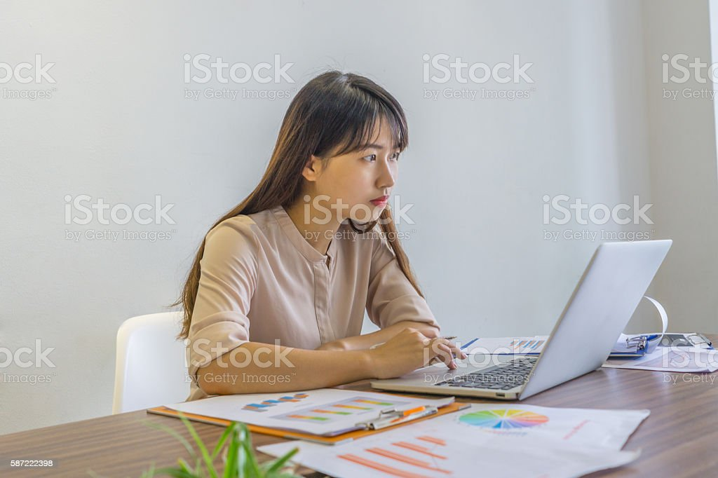 The woman attentively focus on laptop screen while working stock photo