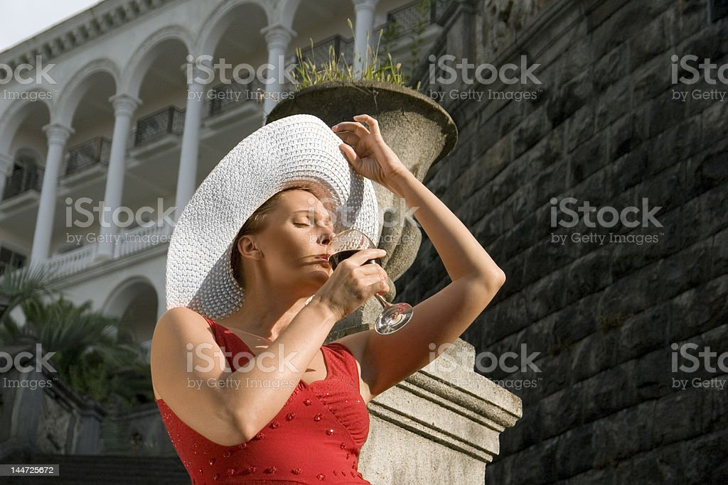 The woman drinks wine. royalty-free stock photo