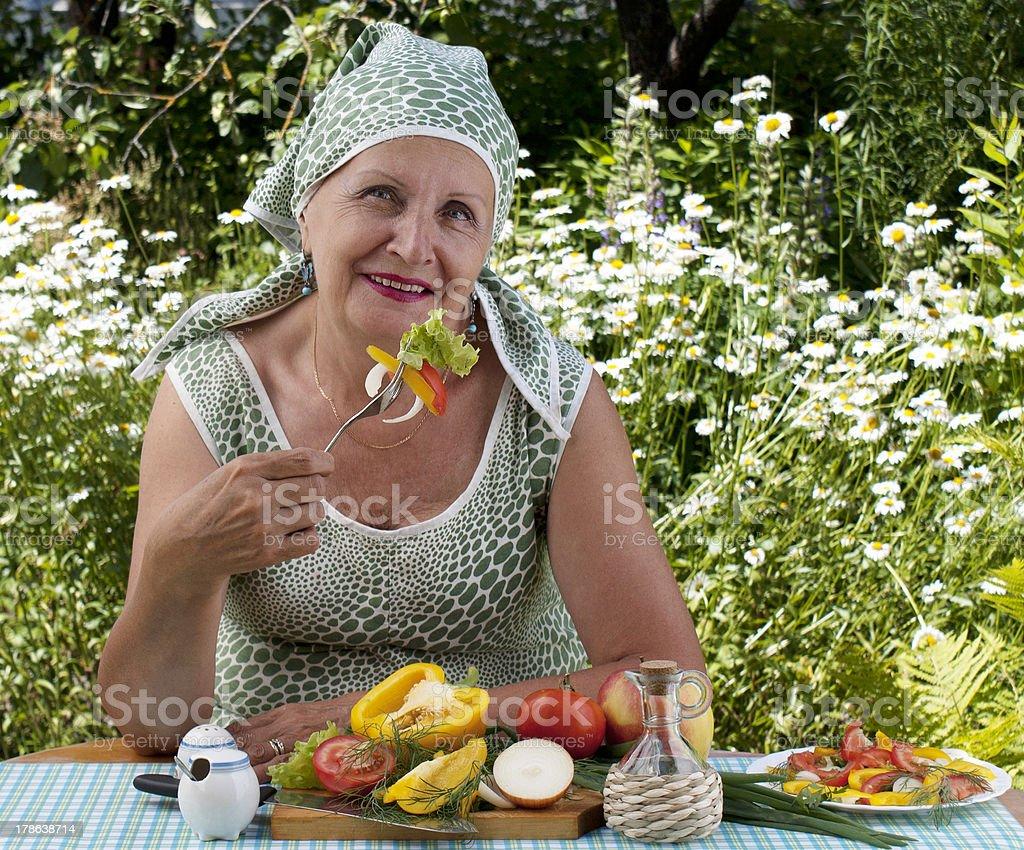 The woman eats salad royalty-free stock photo