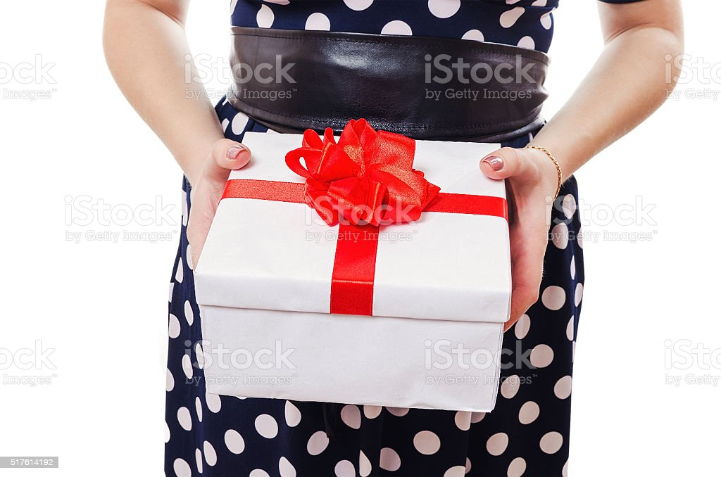 The woman holds a beautiful box in hand stock photo