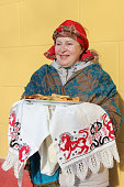 The woman in a red scarf with pancakes