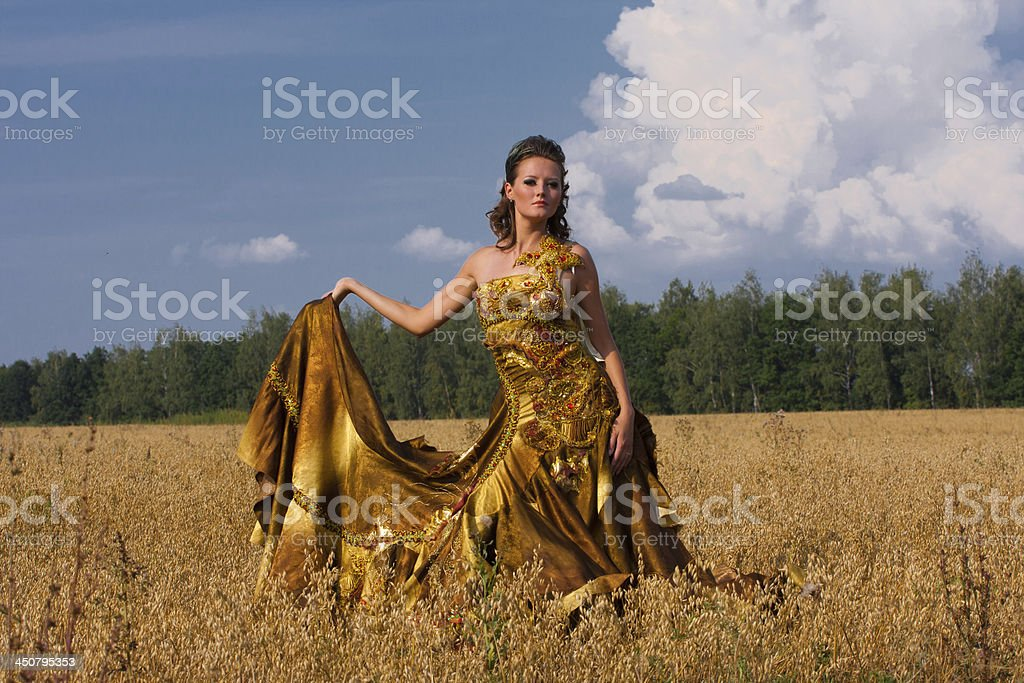 The woman in an old style dress stock photo
