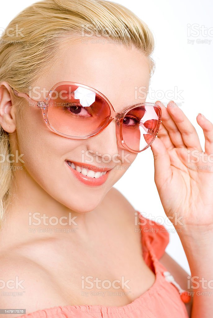 The woman in pink sun glasses royalty-free stock photo