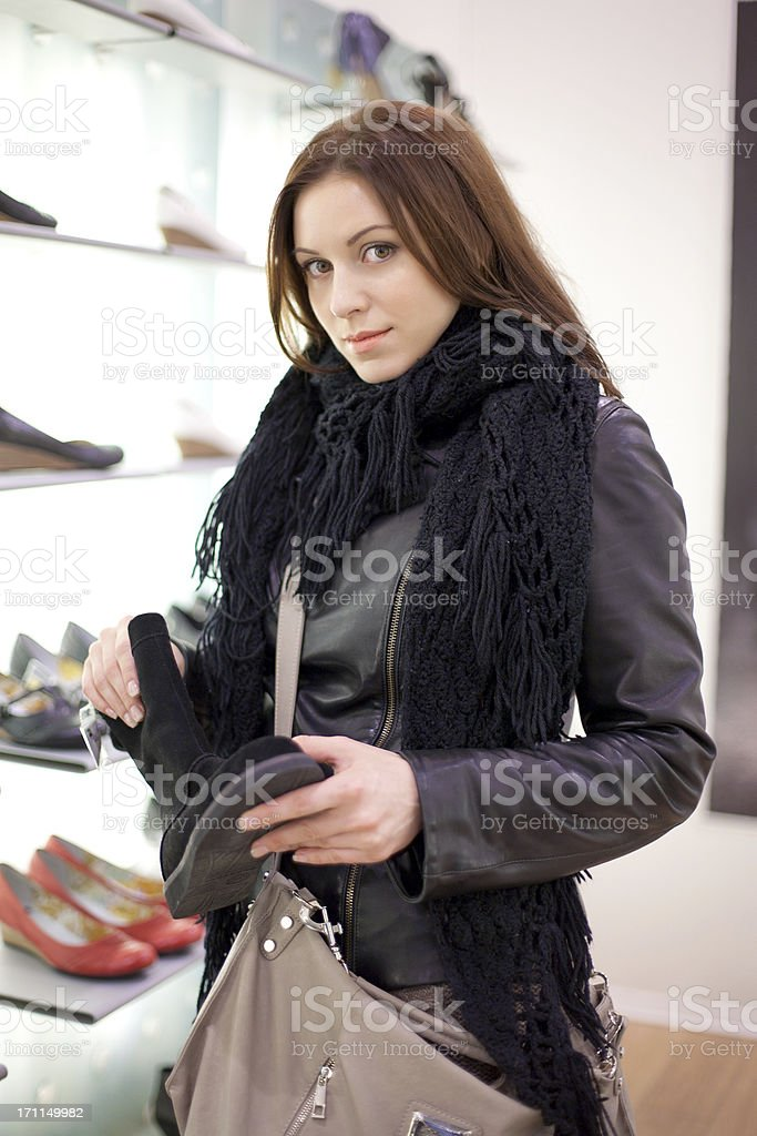 The woman in shoe shop. royalty-free stock photo