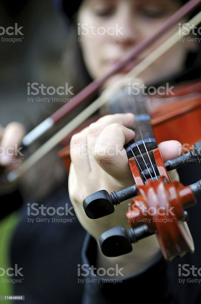 the woman is playing violin royalty-free stock photo