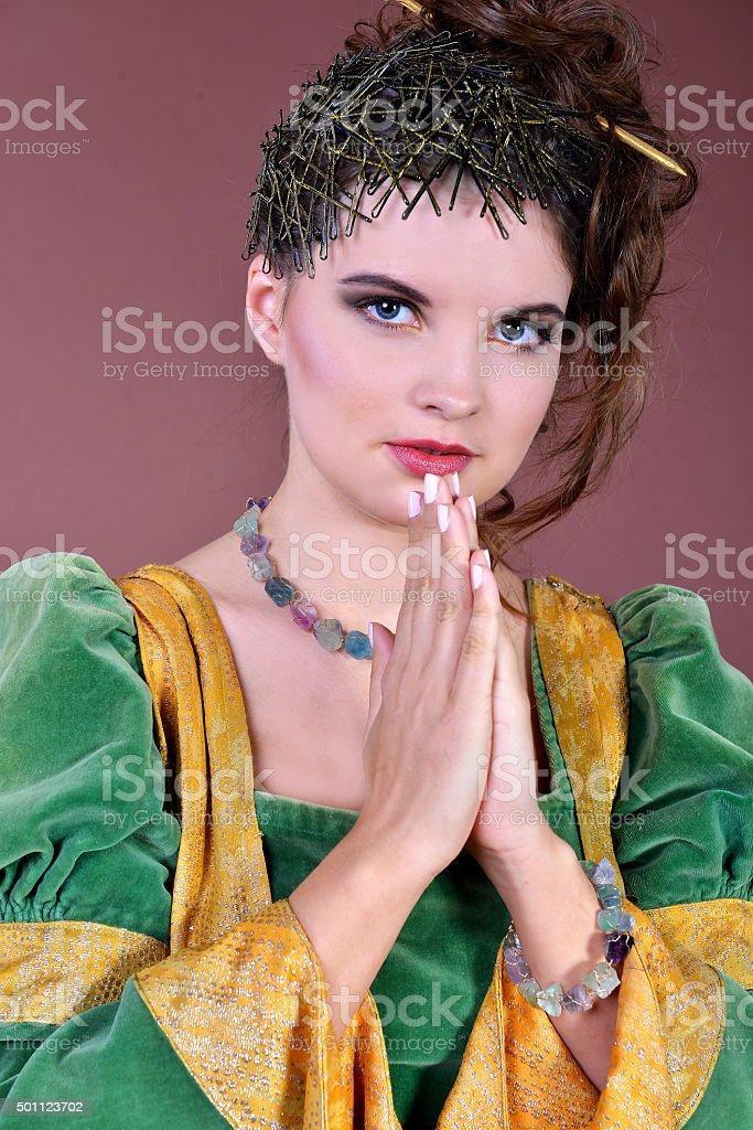 The woman put hands for a prayer, zodiac sign a Sagittarius stock photo