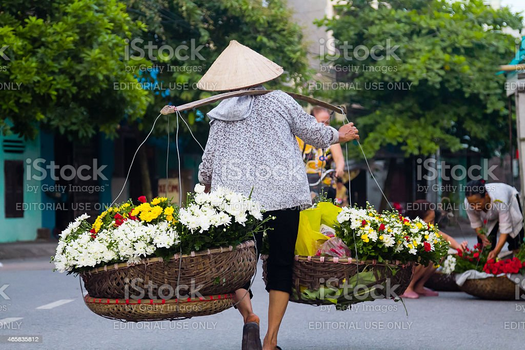 The woman selling flowers early morning stock photo